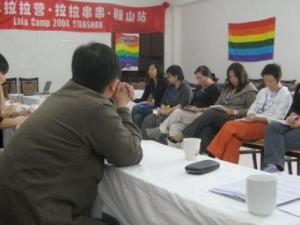 "photo from one of the panel discussions. The banner reads, ""2008 Lesbian Camp, Lesbian Networking, Anshan"""